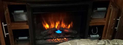 Storage by fireplace | Tracy Marie Lewis | www.stuffnthingz.com